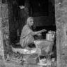 North India: woman coffee seller in Varanasi