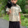 Papua New Guinea: the little girl with the dead bird