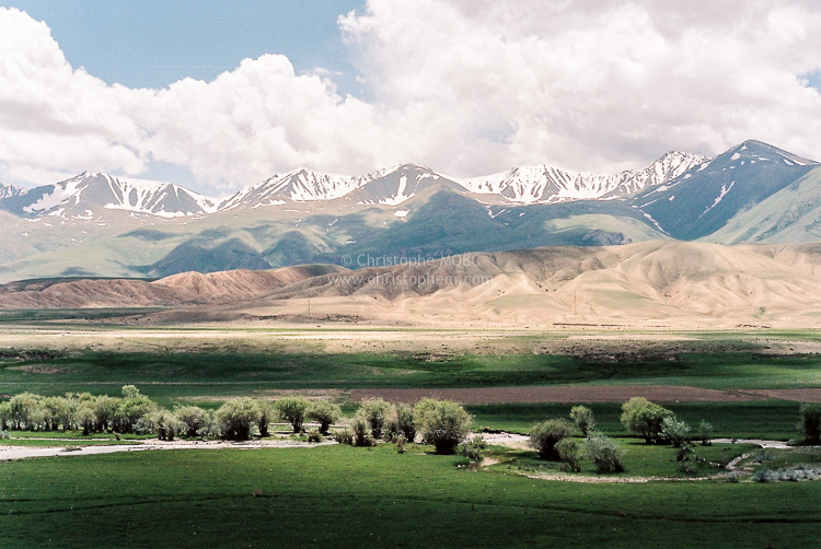 Oasis in the middle of the desert mountains of Central Asia